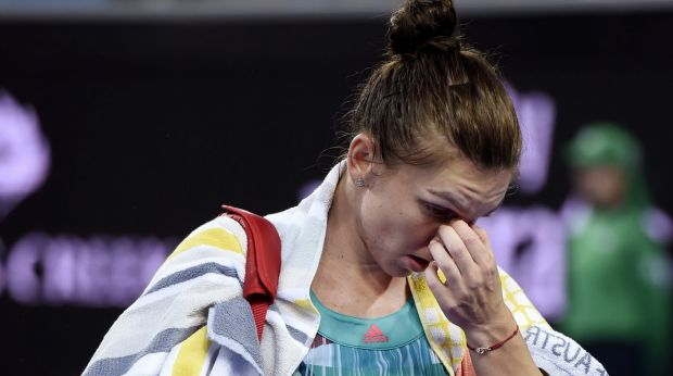 Early exit: Simona Halep leaves the court.