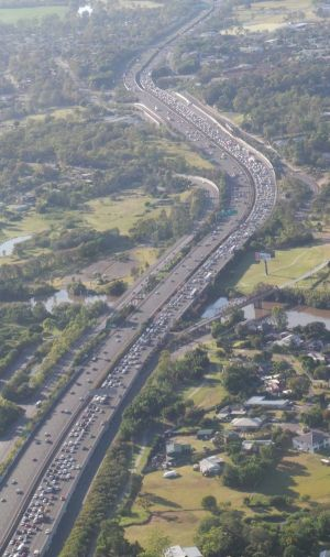 Traffic on the Pacific Motorway is crawling for about 12 kilometres.