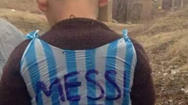Ultimate fan: A young boy is pictured in a hand-made Leo Messi shirt.