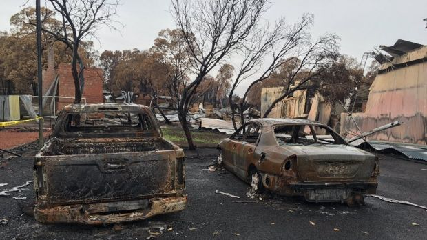 Burnt out cars belonging to volunteer firefighters in Yarloop.