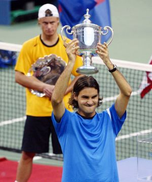Roger Federer after defeating Lleyton Hewitt to win the men's singles title at the US Open in 2004.