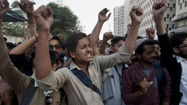 Members of the student wing of Pakistani religious group Jamaat-e-Islami chant slogans during a demonstration to condemn ...