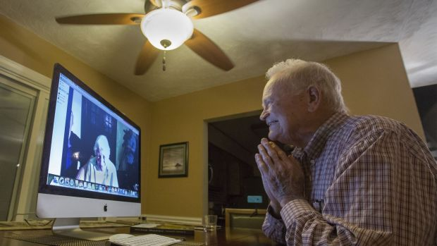Norwood Thomas, 93, talks with Joyce Morris via Skype.