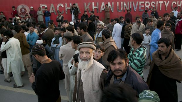 Students' family members stand outside Bacha Khan University.