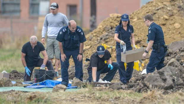 Police sort evidence found in the excavations in Thomastown.