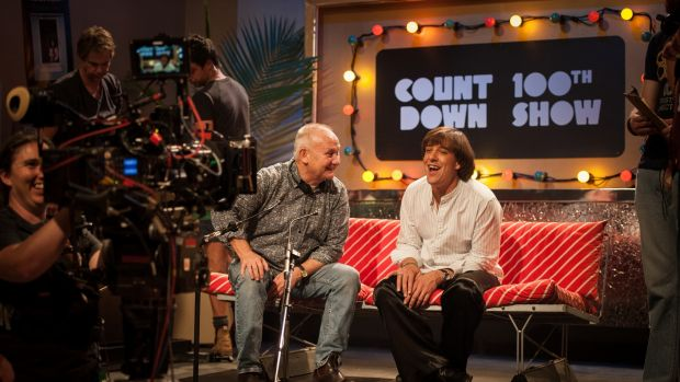 Director Kevin Carlin with Samuel Johnson in character as Molly Meldrum on set of the series 'Molly'.