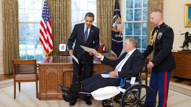President Barack Obama exchanges credentials with Kim Beazley, the incoming ambassador from Australia, in the Oval ...