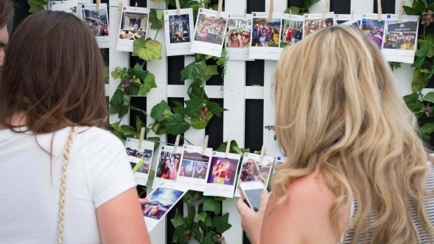 Attendees at the Australian Open using Social Playground printers.