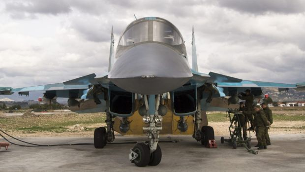 A Russian air force crew prepare a bomber for a combat mission at Hemeimeem air base in Syria in January.