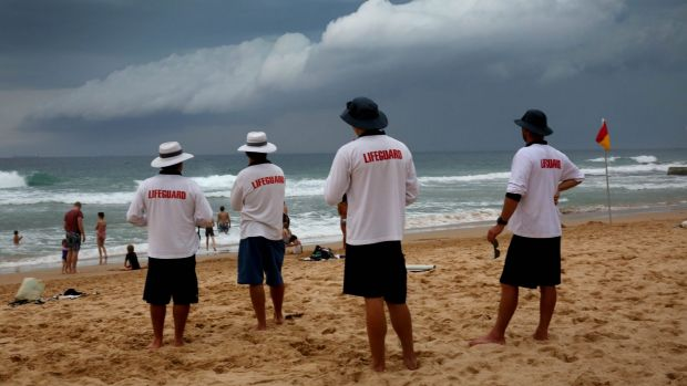 Wollongong City Council Lifeguards watch as a storm front moves up the Illawarra coast at Austinmer beach.