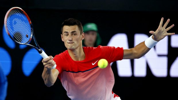 Winning ways: Bernard Tomic hits a forehand return during his second round match against Italy's Simone Bolelli.