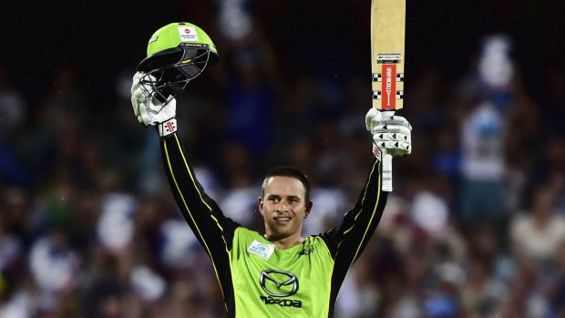 Final fling: Khawaja celebrates his fast century.