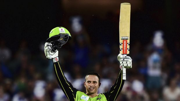 In form: Usman Khawaja raises his bat after scoring his century against the Strikers in Thursday's Big Bash semi-final.