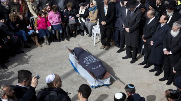 Family and friends of Israeli Dafna Meir attend her funeral at a cemetery in Jerusalem on Monday. A Palestinian attacker ...