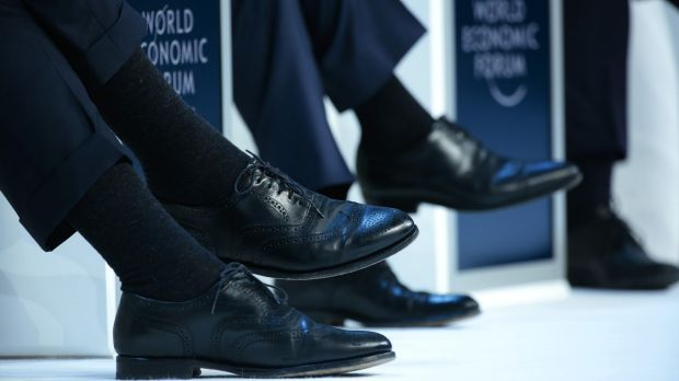 Executive style: speakers during a panel session in Davos, Switzerland, this week.