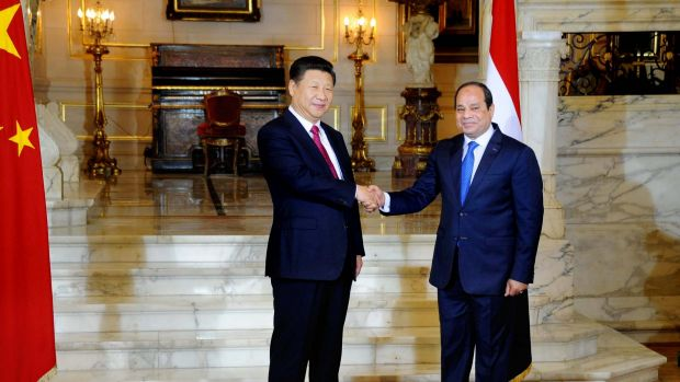 Egyptian President Abdel Fattah al-Sissi, right, shakes hands with Chinese President Xi Jinping.