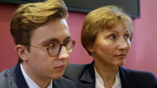 Marina Litvinenko, widow of former Russian spy Alexander Litvinenko, places her arm around son Anatoly during a press ...