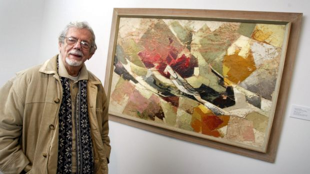 Gil Docking in front of the painting Flight of a Tree, painted by his wife Shay in memory of her brother Ted, who was ...