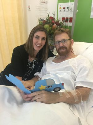 Acting Sergeant Luke Warburton, pictured with his wife, is recovering in Nepean Hospital.