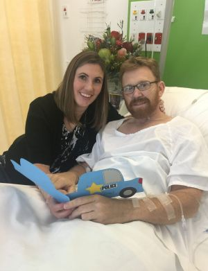 Acting Sergeant Luke Warburton, pictured with his wife Sandra, almost died when he was shot in the femoral artery at ...