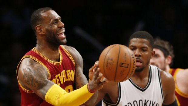 Heavy scrutiny: LeBron James passes the ball.