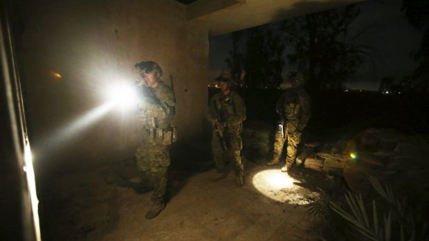 Aussie diggers clear buildings prior to the Iraqi soldiers starting their night time activities.