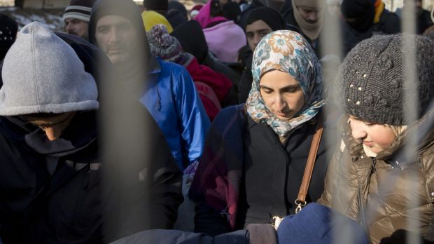 Migrants wait to be allowed to cross the border from Slovenia to Austria on Wednesday. Austria has put a cap on the ...