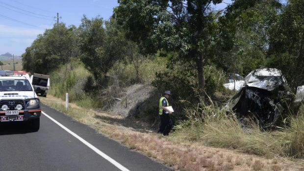 Police at the site of a crash at Hoya, south of Ipswich on Friday.