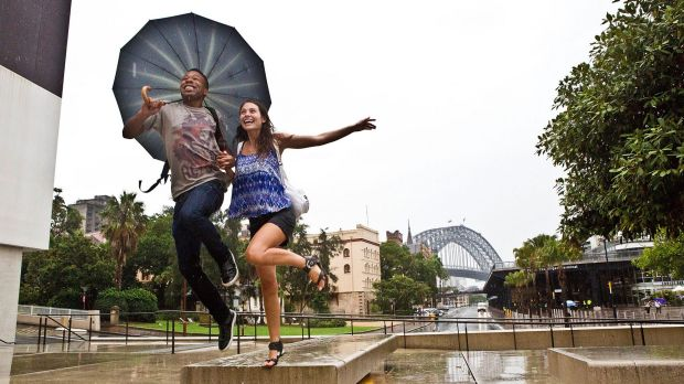 Torris Pelichet of Mosman and Steffy Diciolla of Carlton make the most of the wet weather in Circular Quay on Friday.