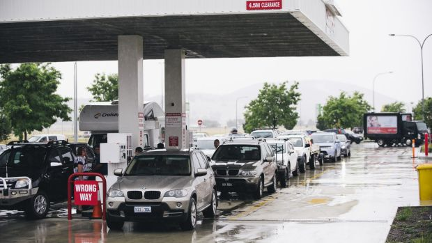 Cars line up for cheap fuel at Costco at Majura Park on Friday.