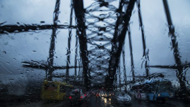Traffic slowed to a standstill across the city, with rain causing heavy delays.