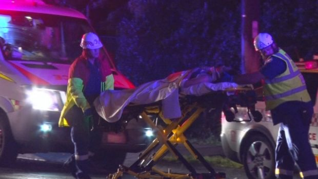 One of the injured is taken by paramedic following the crash.