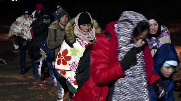 Migrants have been braving sub-zero temperatures as they attempt to cross the border from Macedonia into Serbia.