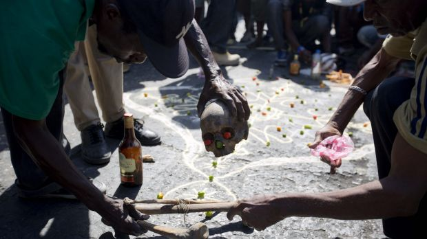 A voodoo ceremony is held prior to a protest against President Michel Martelly's government.