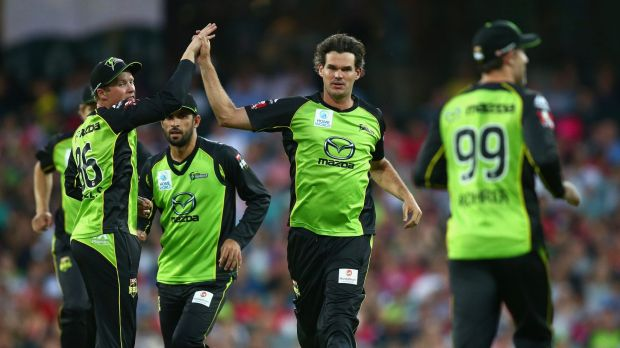 Green machine: Clint McKay and the Thunder celebrate the wicket of Michael Lumb of the Sixers in last weekend's Sydney derby.