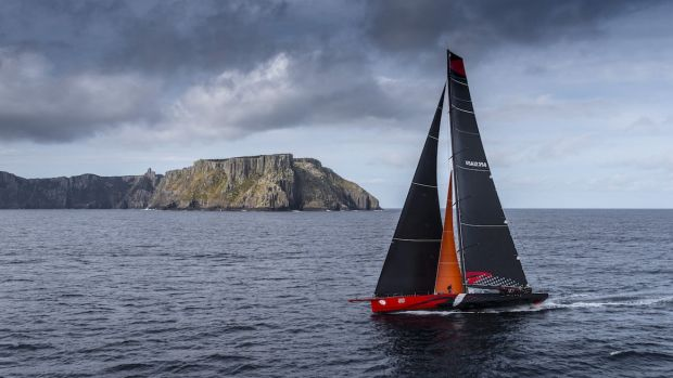 Plane sailing: Comanche rounds Tasman Island on the way to victory in the Sydney to Hobart.