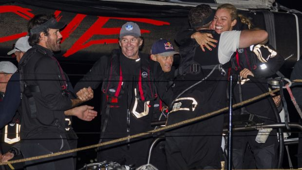 Success is sweet: The crew of Comanche celebrate in Hobart.