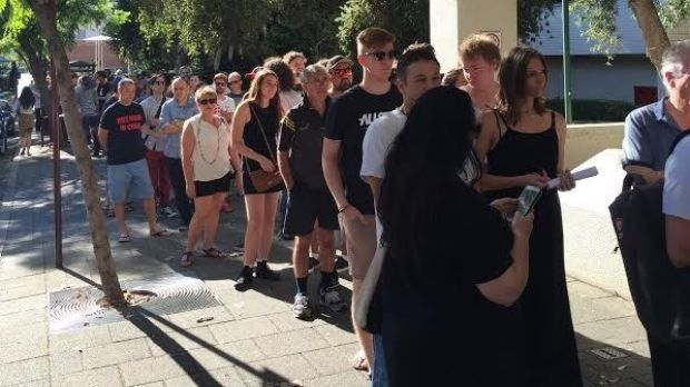 Crowds queue down Hay Street to buy vinyl records at the 6PR bushfire appeal album sale.