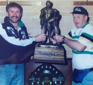 Former Raiders massage therapist Bobby Griffin, right, with the Winfield Cup.