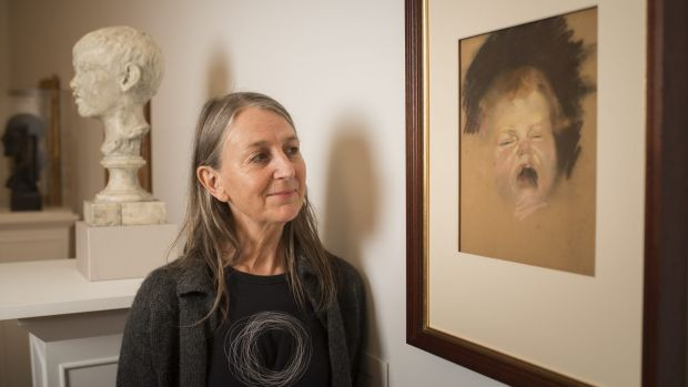 The grandaughter of Australian painter Tom Roberts, Lisa Roberts, with the work she has donated to the National Gallery ...