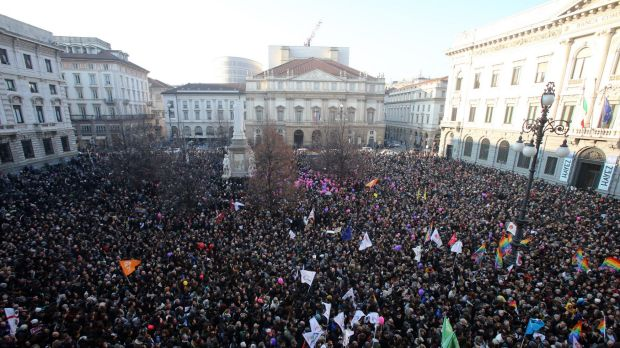 People gather in Milan to support recognition of same-sex couples prior to a debate in Italian parliament.