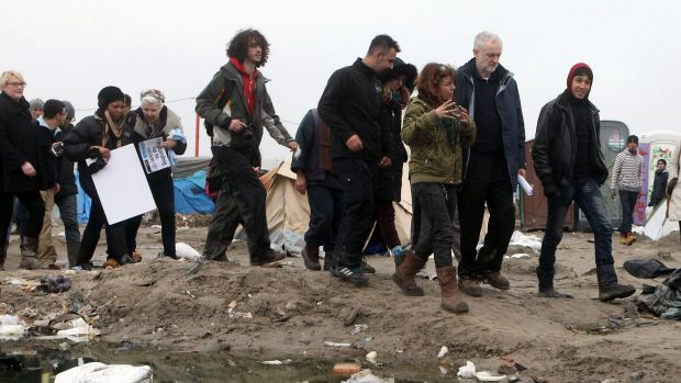 British Labour Party leader Jeremy Corbyn, second right, visits the migrant encampment in Calais, northern France, on ...