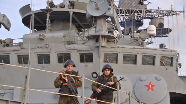 Crew stand guard on the Russian navy destroyer Vice-Admiral Kulakov on patrol in the eastern Mediterranean on Thursday.