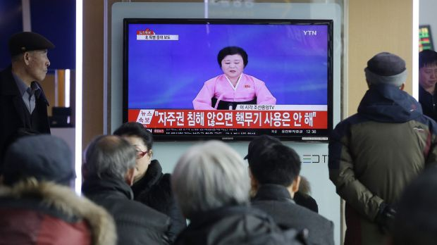 South Koreans at Seoul Railway Station watch a TV news program showing North Korea's announcement of its bomb test ...