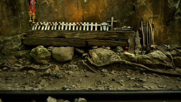 Remembrance crosses sit among the railway sleepers, rail pegs and track at the site of the infamous Hellfire Pass, built ...