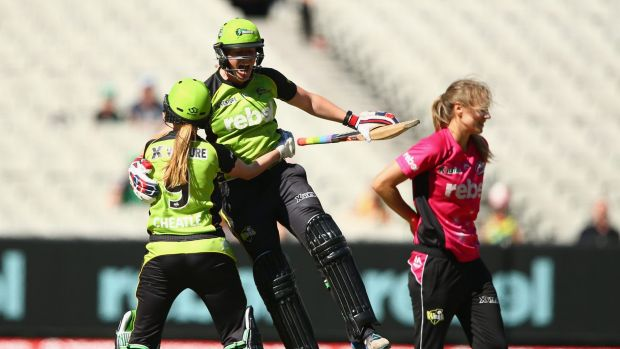 Happy days: Thunder batters Claire Koski and Lauren Cheatle  celebrate after winning the Women's Big Bash League final ...