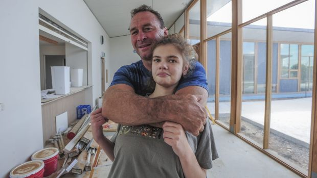With less than a month to go before the building's opening, Ricky Stuart and his 18-year-old autistic daughter, Emma, ...