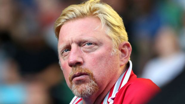 Legend:  Boris Becker, coach of Novak Djokovic, watches from the stands.