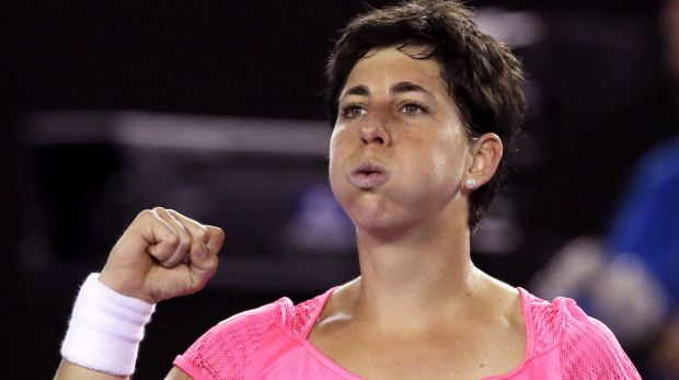 Winning way: Carla Suarez Navarro of Spain celebrates after beating Australia's Daria Gavrilova.