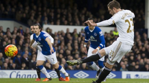 Swansea City's Gylfi Sigurosson scores a penalty during the match against Everton.